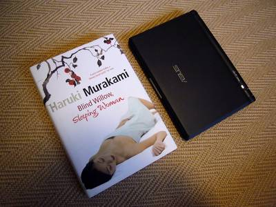 Asus Eee PC and a hardback novel