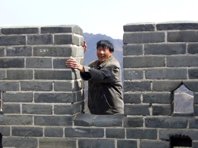 Vendor at Badaling avoiding the entrance fee by scaling the wall