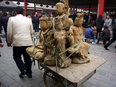 A cart full of Buddhas at Panjiayuan market